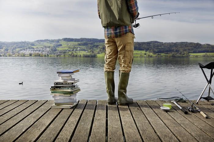 Noe Flum SIX Geschäftsbericht 2014 Stabilität Fischer See Steg Netz Angel Buchstapel